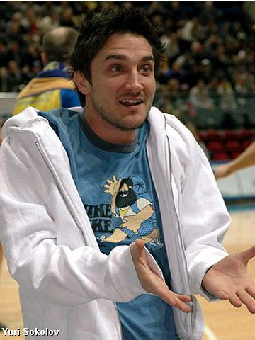 An injured Gianmarco Pozzecco (BC Khimki) watches his team-mates beat Joventut in the EuroCup